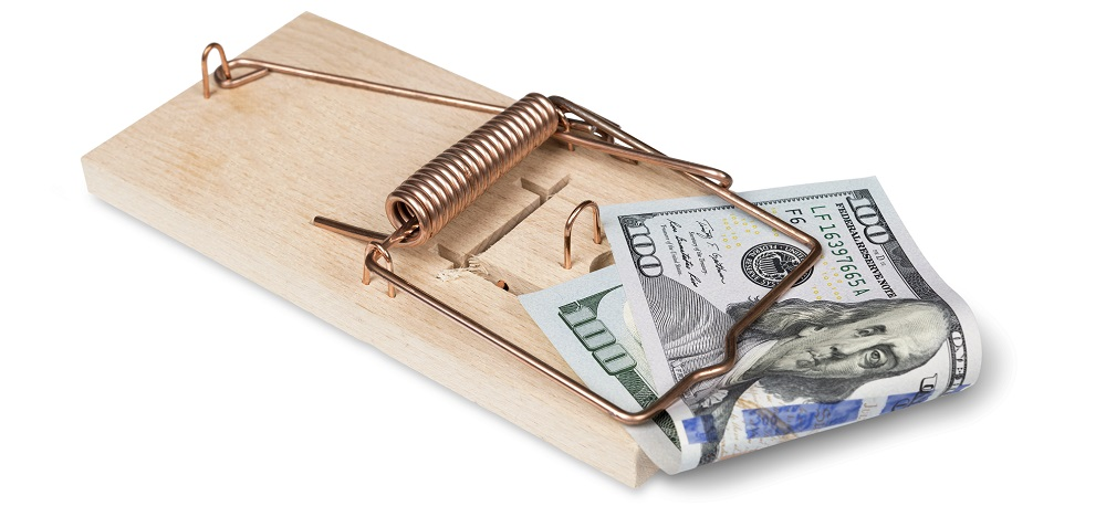 Hundred dollar bill in mouse trap